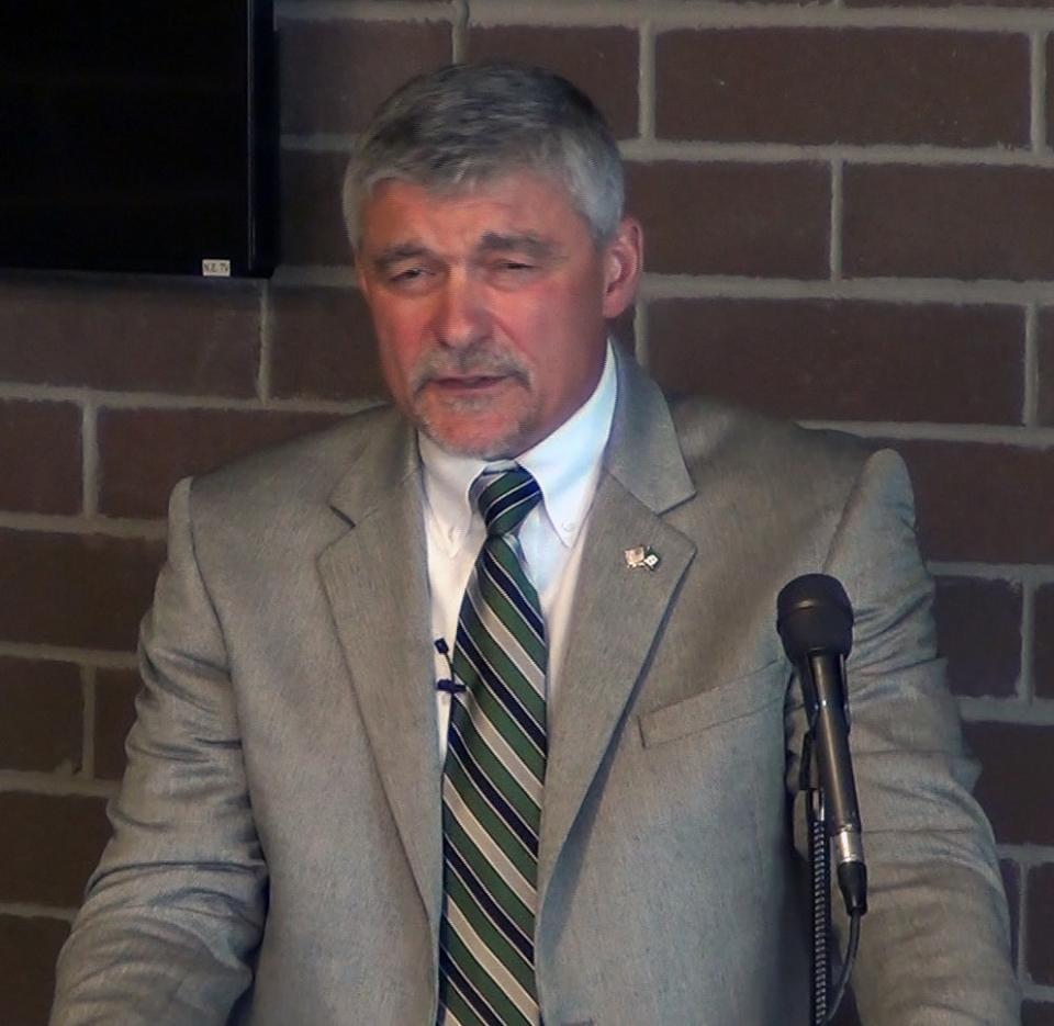 Ken Mannie at podium